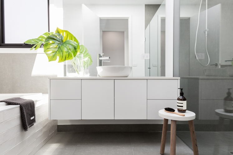 Wall-hung white bathroom basin, with plenty of storage.